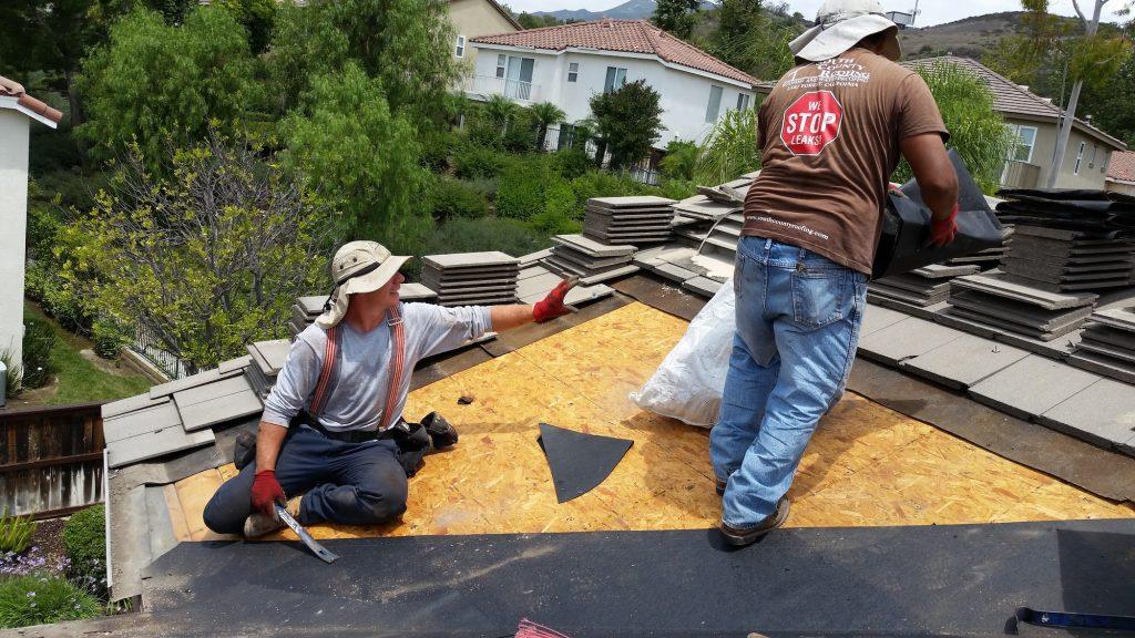 Two guys doing roof repair