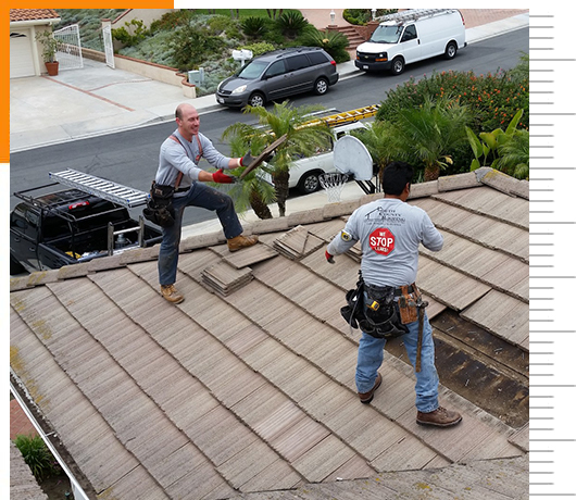 roofers reparing tile roofs